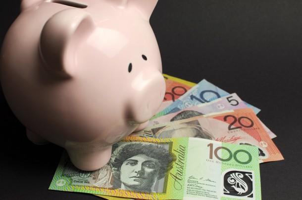 Piggy bank and Australian paper money