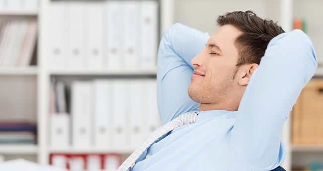 Relaxed Man Leaning Back in Chair with Eyes Closed